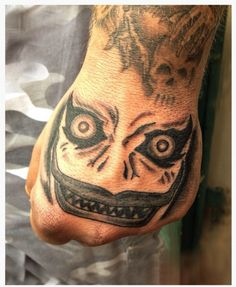 This fist tattoo of Ryuk's creepy but iconic face: