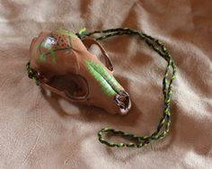 Raccoon skull necklace by Lupa. At http://thegreenwolf.etsy.com