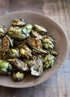 A gently steamed artichoke leaf dipped in melted butter is exquisite, but grilled baby artichokes only improve on a good thing. Don't worry if they ... read more