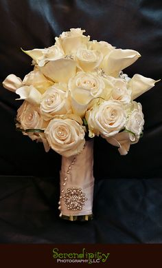 Calla lilies, white roses, and pearls