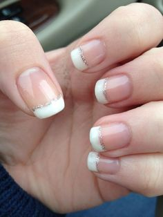 White french tip nails with thin silver glitter line gel french tip nails, french manicure Gel French Tips, White French Tip, Glitter French Tips, French Tip Nail Designs, Ombre French, French Manicure Gel, French Manicures, French Manicure With Glitter, French Tip Acrylic Nails