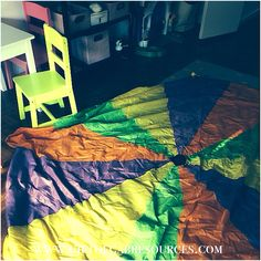 """Our #speechtherapy tool of the day - #parachutes :)  We used it during our #socialgroup and also used it during our individual sessions to target #prepositions #over #under #ontop and #followingdirections such as """"stand on green"""" #slp #slpeeps #slplife #slpbloggers #slp2b #speech #speechpath #speechhpathlogy #speechies #ashaigers #instaslp"""
