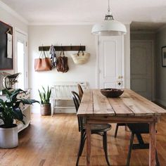 Love the bench and hooks near door, indoor plants and rustic dining table. Lofts, Cozy House, Home Decor Inspiration, My Dream Home, Home And Living, Home Kitchens, Living Spaces, Sweet Home, New Homes