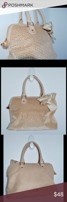 BETSEY JOHNSON PURSE Betsey Johnson tan/beige purse in great condition!   NO TRADES  Will accept reasonable offers!  comment any questions you may have! Betsey Johnson Bags