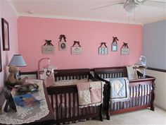 Boy/girl twins nursery room with pink and blue details