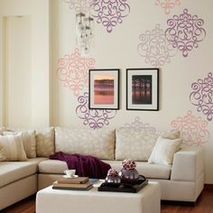 How to create the look of an allover stenciled wall pattern without stenciling the whole wall? Use a repeated stencil motif in a range of colors.