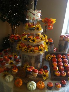 Super cute cupcake tower for a small fall wedding. Beautiful colors and I love sunflowers(:
