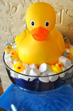 Simple duck centerpiece from the baby shower today.  Oversized baby duck (ordered on Amazon), blue tissue paper for water, marshmallows for bubbles, and small mini ducks.  Voila!