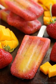 Beat the summer heat with these Strawberry Mango Chia Popsicles! Fresh fruit, chia seeds, and coconut water is all you need to whip up these hydrating pops.