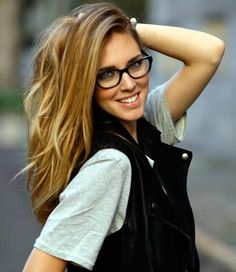Beautiful nerd trending with those fashion black glasses.  Love the hair color blonde highlights.