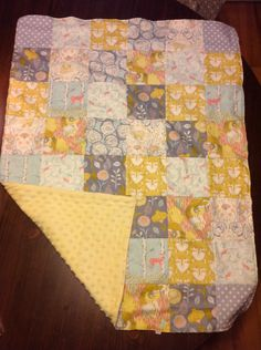 Timber and leaf minky backed baby quilt or crib blanket. $40.00, via Etsy.