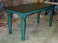 I  really like the turquoise bottom and wood top combo in a table.