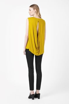 Top with open back, COS  BP 20, $30