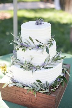 white wedding cake with greenery for summer wedding lavender bridesmaid dresses grey men's suits and centerpieces Sage Wedding, Wedding Cake Rustic, Elegant Wedding Cakes, Wedding Cake Designs, Purple Wedding, Wedding Lavender, Lavender Cake, Lavender Wedding Decorations, Rustic Chic Weddings