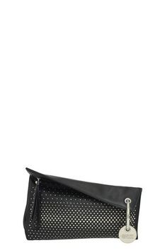 The Marc Jacobs Prism Dégradé Studs Clutch is made from calf leather with studded embellishments. Details: side zip with leather extender; circular medallion; The Prism Clutch is detailed with a circular, embossed metallic monogram tag, attached to a silver-toned ring.
