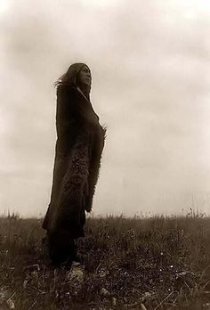 Here for your perusal is a collectible photograph of Crying Spirits, a Hedatsa Indian. It was created in 1908 by Edward S. Curtis.    The photograph illustrates this Hidatsa Indian standing in a field, wearing fur robe..    We have compiled this collection of photographs mainly to serve as a valuable educational resource. Contact curator@old-picture.com.