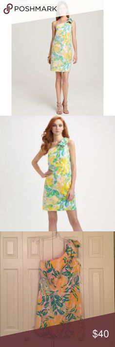 Lilly Pulitzer Floral Chloe One Shoulder Dress The tropical print brightens this body-skimming one-shoulder silhouette, finished with an oversized shoulder bow.  Perfect for a lawn party, horse race, dinner out or just because.               Purchased fro