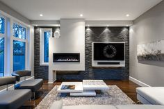 Love the dark stone wall with the white.