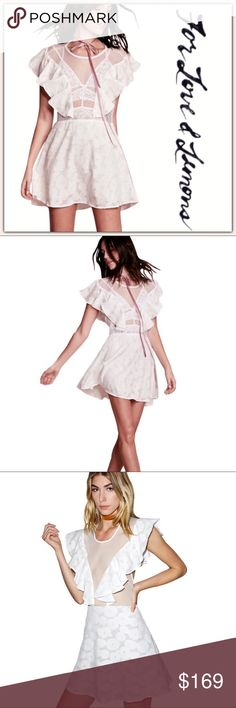 NWT For Love and Lemons Silk Buttercup Mini Dress ➖NWT ➖BRAND: For Love and Lemons  ➖SIZE: Medium ➖STYLE: Buttercup Mini Dress : Soft ruffles accent the mesh bodice of this dress. Tonal floral appliqués cover the skirt. There are cap sleeves and the dress ties at the neckline at the back. The skirt is lined.  ➖MATERIAL:      ➖Shell : 55% Silk 45% cotton      ➖Trim:  100% nylon     ➖Lining: 97% Polyester 3% Spandex  * bra in the first two photos not included  ❌ NO TRADE  prom homecoming short…