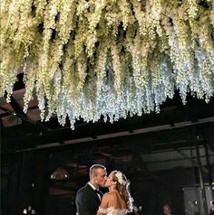Ceiling flowers to die for!  Photo by Inlighten Photography at Doltone House Jones Bay Wharf #wedding #floral #flowers #weddingflowers #ceiling #modernweddingmagazine #luxurywedding #stylinghandbook