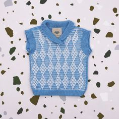 Vintage style inspired sleeveless jumper handknitted of Van Beren Organic Cotton Yarn for toddler in two colour diamond pattern. Cotton Plant, Organic Cotton Yarn, Sleeveless Jumper, Natural Clothing, Diamond Pattern, Archer, Colored Diamonds, Hand Knitting, Knits