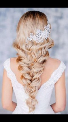 Long blonde curls met with a subtle braid, and with a dash of sparkle. LOVE IT!