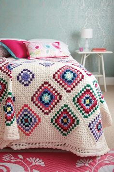 Worked in trebles with dc and shell edged border in a colourful palette, this granny square blanket would make a stunning on-trend addition for your home.