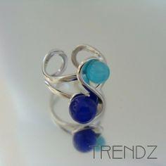 Anillo azul de ojo de gato ajustable bañado en rodio |  Cat´s eye adjustable blue ring