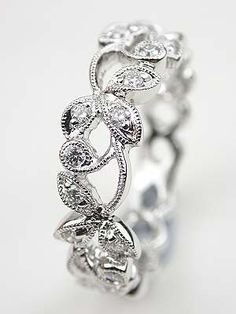 Diamond Wedding Ring with Vine and Leaf Motif... o.o I refuse to even look at the link for fear of the price.. but pretty anyhow, lol!