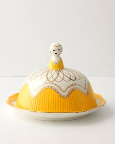 Butter Dish: This is more than a butter dish; it's a conversation starter! Milkmaid butter dish in yellow, anthropologie.com.