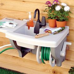 Outdoor sink.  No {extra} plumbing required. great for the kids to wash hands outside. connects to any outside spigot. REAL-ly?
