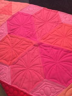 """At long last, I can declarethis amazing quiltfinished! Quilt Stats:Pattern: Gravity by Jaybird QuiltsFabrics: 114Kona solids!Quilting: Custom by Happy Me QuiltingSize: 97"""" x 96""""   I am going to let"""