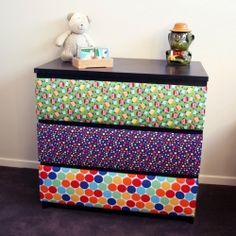 Upholster the chest of drawers drawer fronts with your fabric choice. Even use a sheet, vintage fabric, burlap, tablecloth or recycled jeans!  Who would have thought? Awesome for kids rooms.