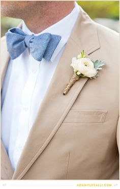 Simple cream and green boutonniere with the bottom wrapped in twine.  Flowers by Fresh Cut Catering  Floral.   Bow tie and khaki suit with groom boutonniere.  Planning by http://www.shannalumpkinevents.com/index2.php#/home/   Photo by www.adamplusalli.com