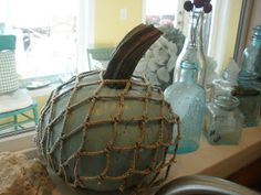 Dress up a pumpkin with fish net for a nautical look.