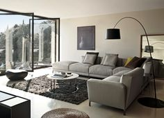 Living Room, L Shaped Couch Overstuffed Gray Color With Standing Lamp Black And Large Windows From Transparent Glass ~ Appealing Living Room Decorating Ideas along with Sectional Sofa and Small Coffee Table