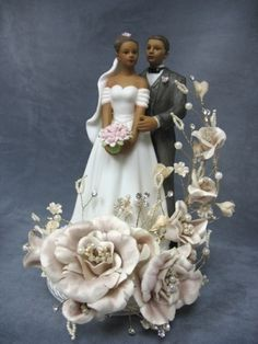 This beautiful recreation vintage cake top showcases a sprig of silk roses accented with faux pearls and crystals with an elegant fine porcelain African-American wedding couple. Base is fine porcelain. Wedding Cake Fresh Flowers, Black Wedding Cakes, Horse Wedding, Dream Wedding, Wedding 2017, Vintage Cake Toppers, American Cake, Pink Rose Bouquet, African American Weddings