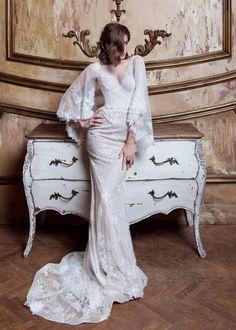 Wedding dress Emmanuel by Ange Etoiles. V-neck elegant cape sleeves mermaid wedding dress with train. Ship worldwide. Based in Vancouver, Canada.