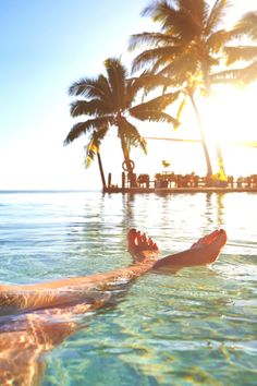 wavemotions:    Legs of caucasian girl relaxing in tropical ocean