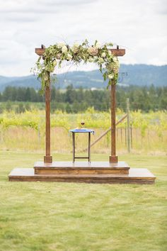 Love! Stunning floral decor surrounds this alter with a magnificent #vineyard as that backdrop {Crystal Madsen Photography}