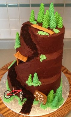 We're imagining rich chocolate icing, with gooey fudge cake underneath and toffee wooden trails? Mountain Bike Cake, Mountain Biking, Cupcakes, Cupcake Cakes, Bike Cakes, Fondant Cake Designs, Dad Cake, Gateaux Cake, Creative Desserts