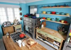 My dream kitchen! Love all the different colors, butcher block counters and lots and lots of Le Creuset cast iron pots and pans! Diy Kitchen, Kitchen Dining, Kitchen Cabinets, Kitchen Ideas, Chef Kitchen, Happy Kitchen, Boho Kitchen, Kitchen Pantry, Kitchen Designs