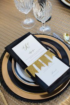 Shimmering gold and black place setting by Emily Clarke Events with china from Posh Couture Rentals. Photo by John Cain Photography. #wedding #placesetting #gold #black #luxe #bunting
