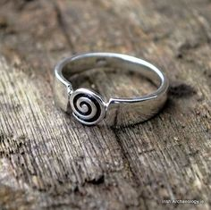 This beautiful silver ring is decorated with a spiral motif that is inspired by prehistoric Irish art.