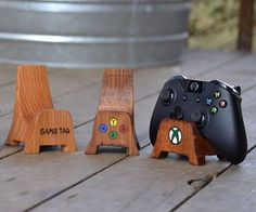 Game Console Controller Stands - CoolShitiBuy.com | Add some new life to your gaming room setup with these awesome wooden game console controller stands. Personalize the controller stands with your GamerTag or the logos of xbox, playstation, nintendo etc. The controller stands come in two Stand Designs: V-Shaped, and Chair.', 'pinterest-share-dialog', 'width=626,height=500'); return false;