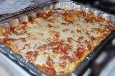 Ingredients:      2 – lbs ground beef 1 – 48 oz jar spaghetti sauce 2 – tablespoons sugar 1 (16 oz) – pkg medium egg noodles 1/2 – cup margarine or butter ½ – teaspoon onion salt (or onion powder) ½ – teaspoon garlic salt (or garlic powder) ½ – cup grated Parmesan cheese 1 – 12 oz pkg shredded mozzarella cheese Instructions:    Preheat oven to 350º Brown meat and drain fat. Add spaghetti sauce and sugar to meat; simmer 20 minutes. Cook noodles as directed (AL dente); drain and toss with…