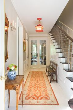 Elegant Townhome in Pasadena - traditional entry with a more transitional look to the staircase and great use of color.