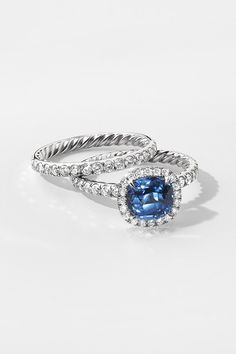 DY Capri Engagement Ring with Blue Sapphire in Platinum and DY Eden  Eternity Wedding Band in Platinum with Diamonds.