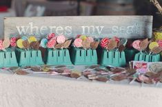 what a fun escort card/favor idea!  lollipops displayed in berry baskets