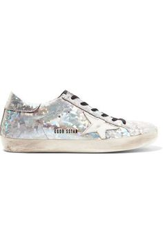 "Golden Goose Deluxe Brand's cult 'Super Star' sneakers are re-imagined in silver leather with a 'shattered' finish for Spring '17. This low-top pair is brushed and waxed by hand for an authentic, lived-in feel. For styling, look to The EDIT - ""there is nothing a metallic accessory won't work with, no look that it won't instantly crank up a notch - or 20."""